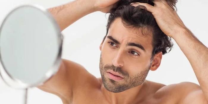 szampon dx2 w czarnej tubie ma przeciwdziałać łysieniu